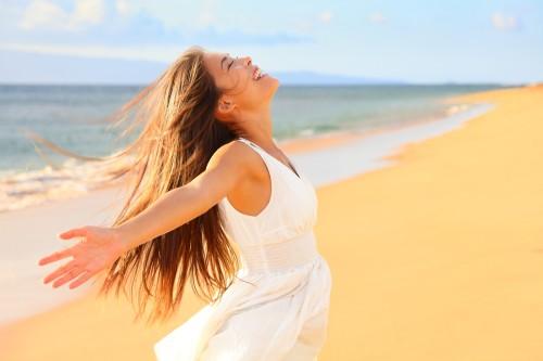 Free happy woman on beach enjoying nature. Natural beauty girl o