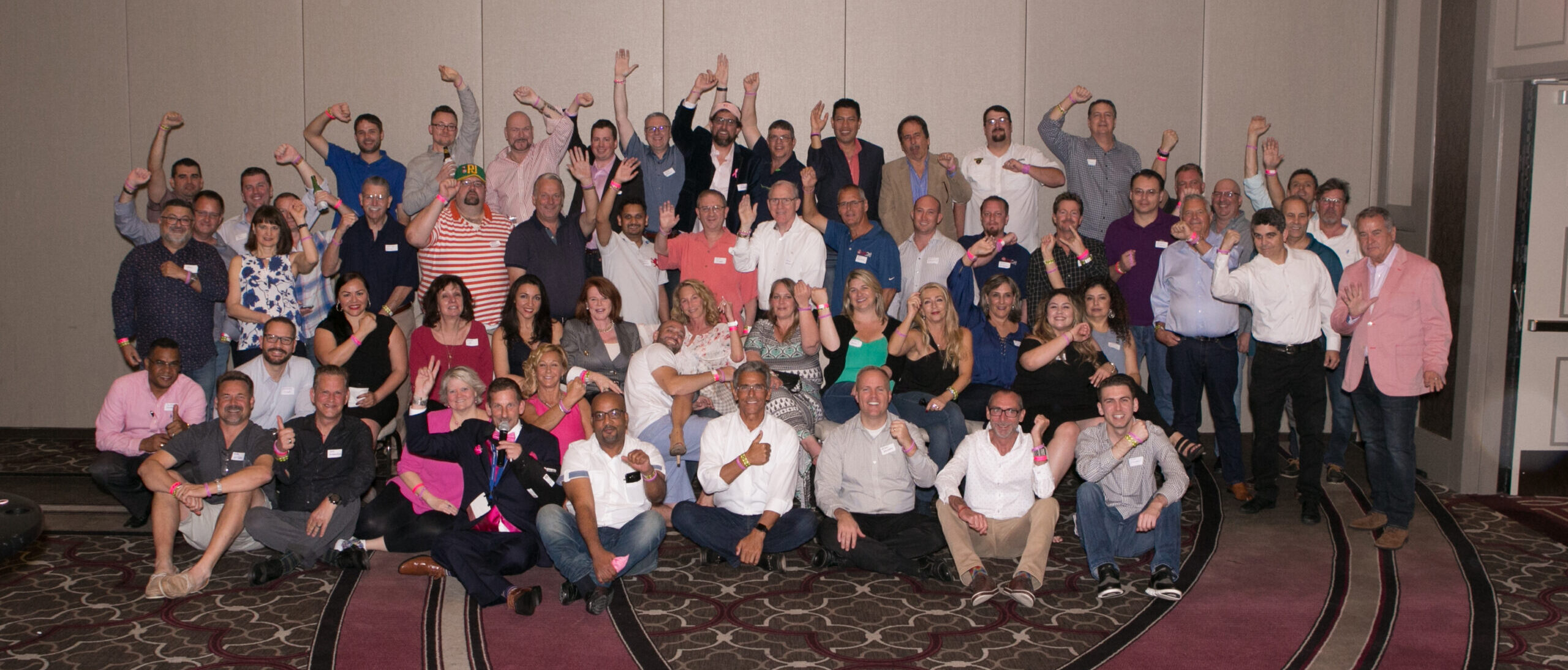 2017 trackresults poker players group photo with pink wristbands